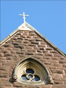 New stonework and metal cross above West end